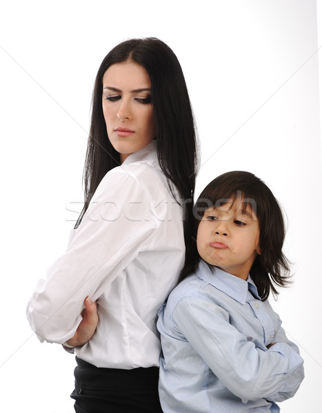 Mother and son standing back to back having relationship difficulties on white background Stock photo © zurijeta