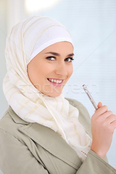 Muslim Caucasian female student holding pen Stock photo © zurijeta