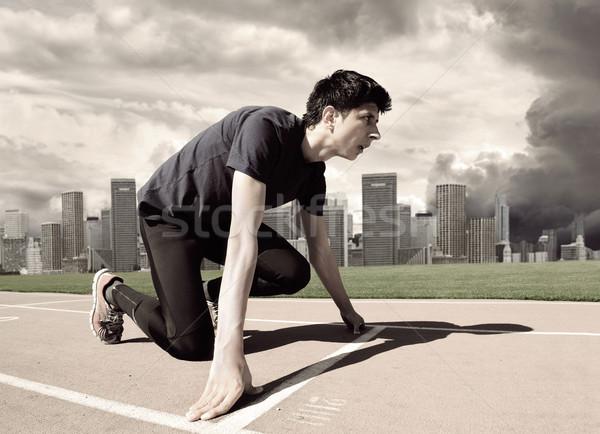 Fiatal férfi atléta kezdet futópad stadion Stock fotó © zurijeta