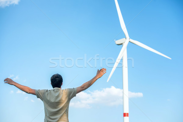 Man standing by wind turbine Stock photo © zurijeta