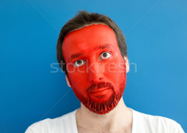 Man wearing shirt and painted red face Stock photo © zurijeta