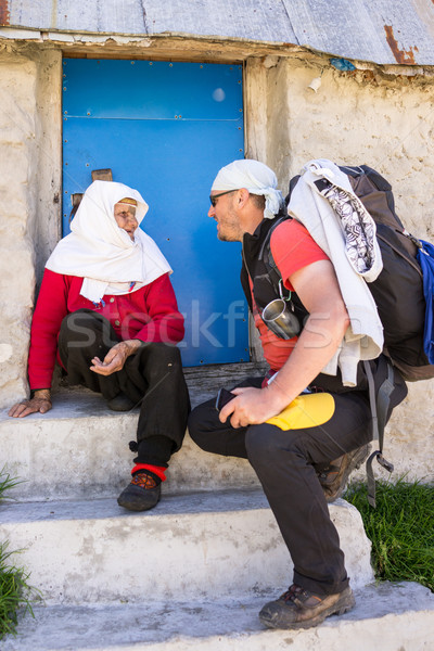 Hiker backpacker talking to old woman on mountain Stock photo © zurijeta