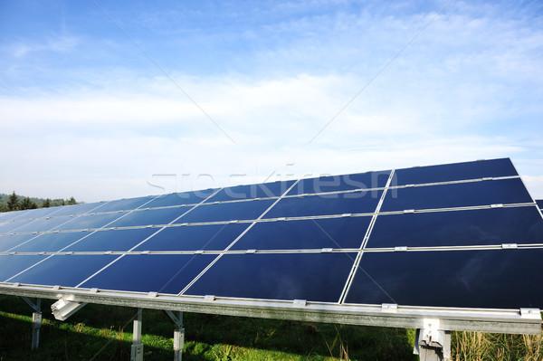 Alternatív energia fotovoltaikus napelemek kék ég épület Stock fotó © zurijeta