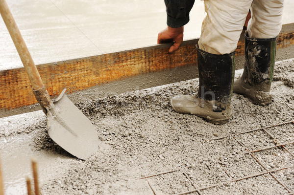 Man leveling concrete slab Stock photo © zurijeta