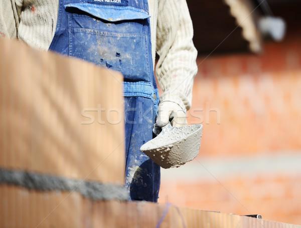 Werken gebouw project werknemer nat Stockfoto © zurijeta