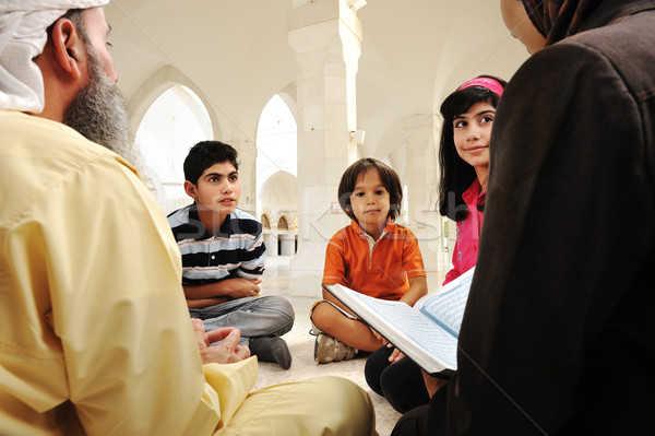Islamic education inside white mosque, teacher and children learning together (or mother and father  Stock photo © zurijeta
