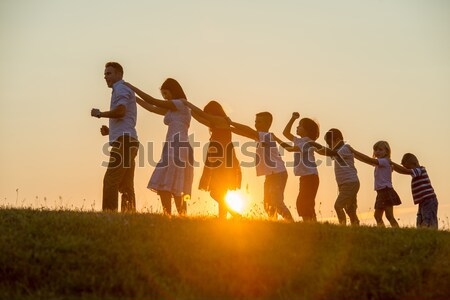 Beautiful scene of children jumping in nature Stock photo © zurijeta