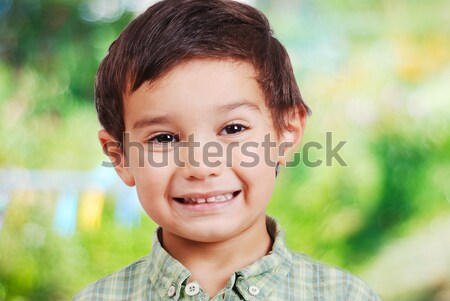 Cute kid with smile grimace Stock photo © zurijeta