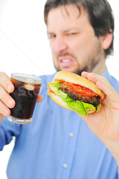 Unsatisfied man with his burger and coke Stock photo © zurijeta