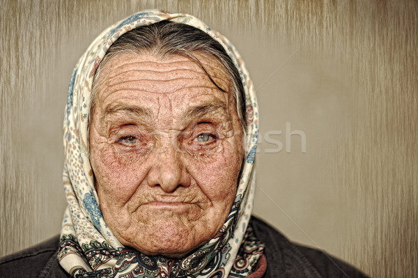 Portrait of mature woman with green eyes and scarf on head Stock photo © zurijeta