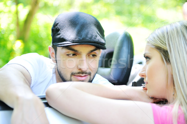 Picture of a man in a car and his girlfriend outside Stock photo © zurijeta