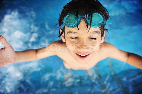 Children activities in swimming pool Stock photo © zurijeta