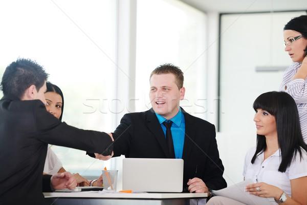 Feliz pessoas de negócios aperto de mãos tratar sorridente trabalhando Foto stock © zurijeta