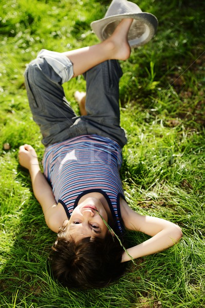 Relaxed child resting on summer park grass meadow Stock photo © zurijeta