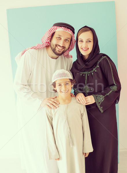 Arabic family posing and smiling Stock photo © zurijeta