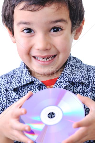 boy and cd dvd media Stock photo © zurijeta