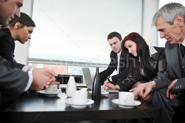 Portrait of director  having coffee in office meeting Stock photo © zurijeta
