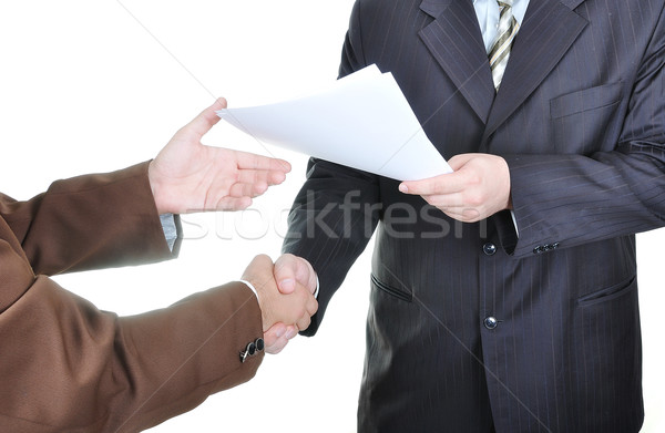 Stock photo: Two businessmen hands and the key, paper agreement