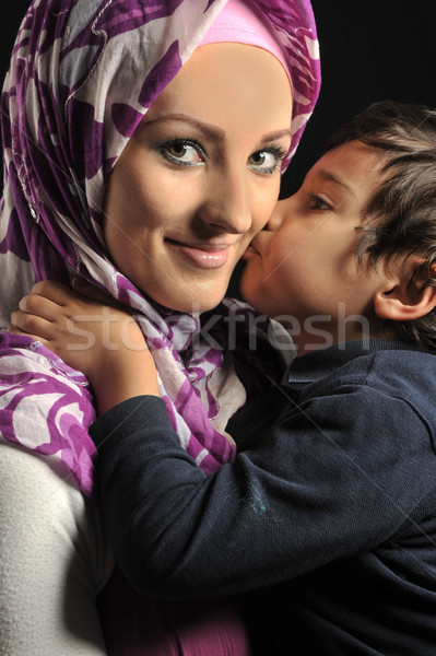 Muslim young woman with little cute kid Stock photo © zurijeta