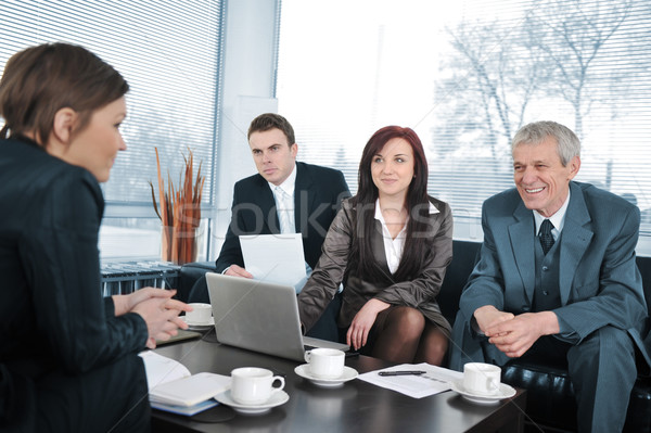 Businesswoman in an interview with three business people getting positive feedback Stock photo © zurijeta