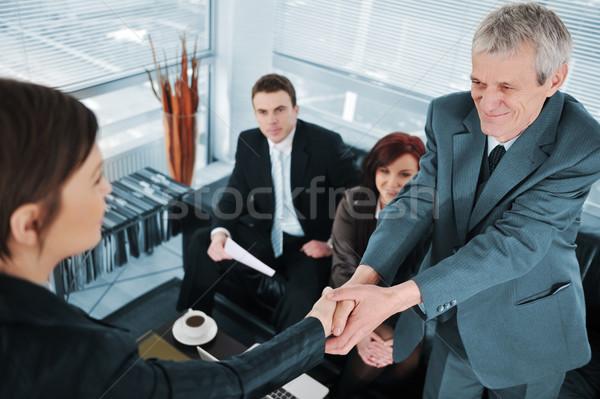 Bem sucedido entrevista de emprego negócio mulher mão sorrir Foto stock © zurijeta