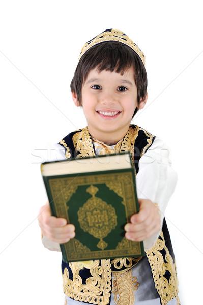 Happy muslim kid holding holy Quran Stock photo © zurijeta