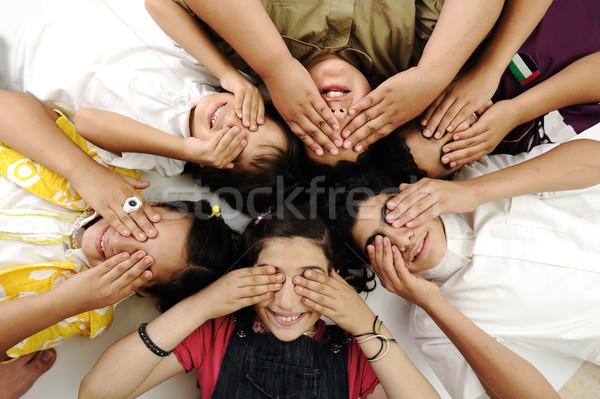 Happy children laying on ground closing eyes Stock photo © zurijeta
