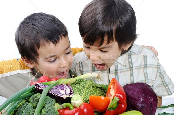 Two little boys eating vegetables Stock photo © zurijeta