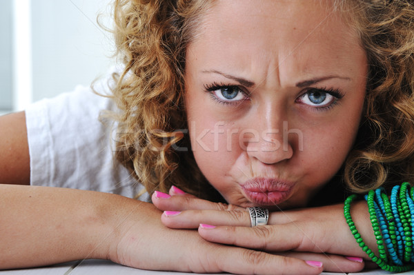 Teen girl zły grymas strony twarz szczęśliwy Zdjęcia stock © zurijeta