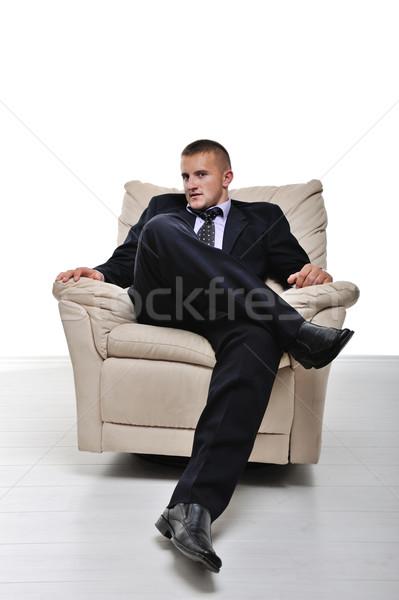 Imprenditore seduta poltrona gambe incrociate isolato ufficio Foto d'archivio © zurijeta