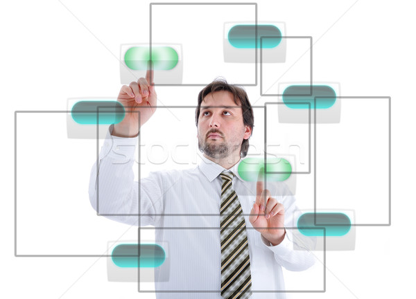 Young male person pressing digital buttons on touchscreen Stock photo © zurijeta