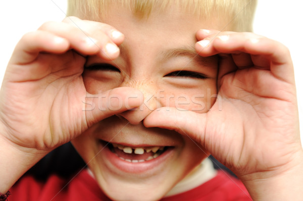Happy blonde boy closeup, smiling, laughing, very happy with hands on his face Stock photo © zurijeta
