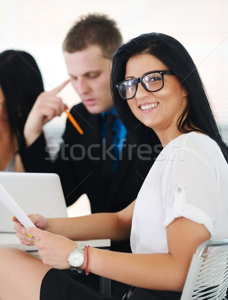 Image of confident colleagues communicating at meeting Stock photo © zurijeta