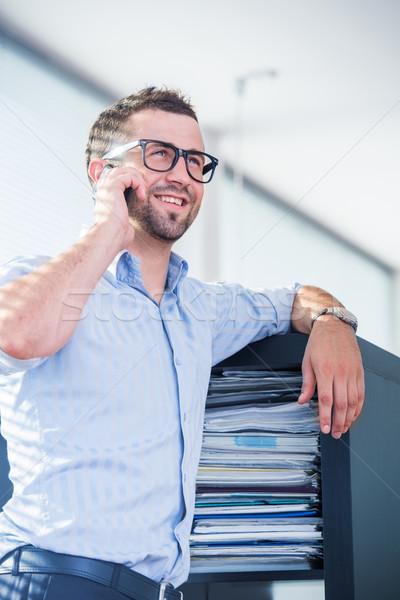 Happy corporate men with cellphone Stock photo © zurijeta