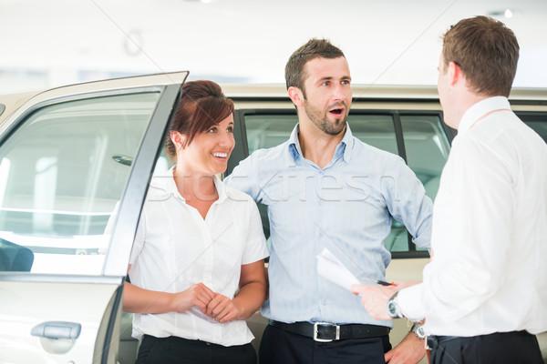 Happy couple with car salesman Stock photo © zurijeta