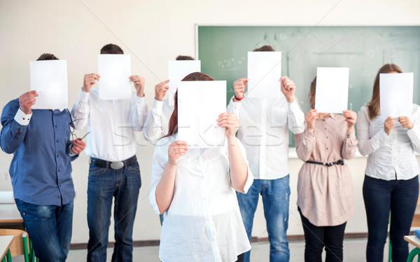 Kolej Öğrenciler kağıtları boş kağıt kız Stok fotoğraf © zurijeta