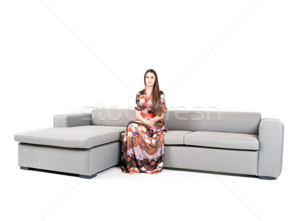 Young attractive woman on sitting on sofa Stock photo © zurijeta
