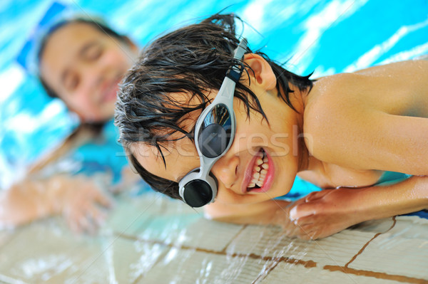 Beautiful kids in pool Stock photo © zurijeta