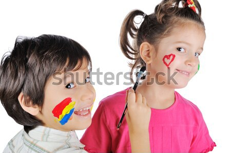 Messy children with paint on their hands and faces with thumbs up Stock photo © zurijeta