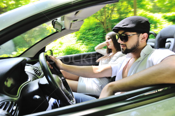 Beautiful couple enjoying nature in a sports car Stock photo © zurijeta