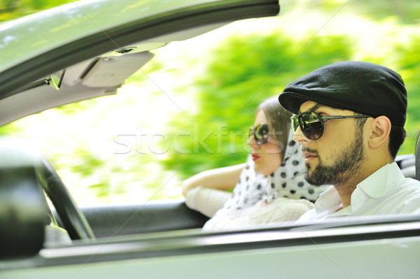 Young couple enjoying in car at fast pace Stock photo © zurijeta