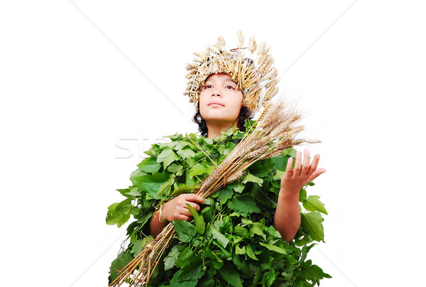 Nice little girl in leafs cloths with wheat hat on head Stock photo © zurijeta