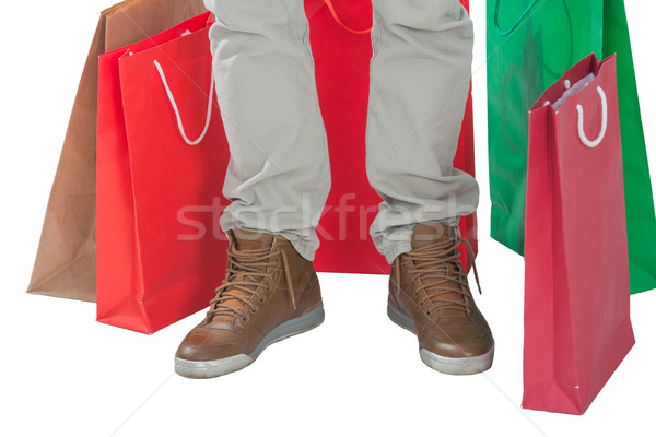 Man surrounded by shopping bags Stock photo © zurijeta