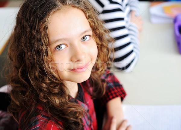 Aranyos iskolások oktatás tevékenységek lány boldog Stock fotó © zurijeta