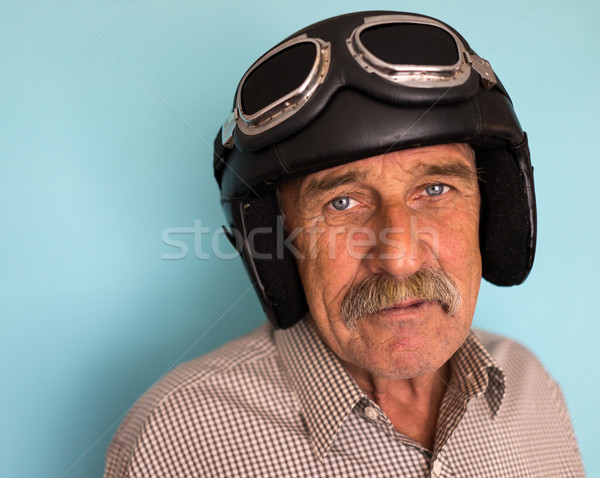 Senior funny man as a pilot with hat and glasses Stock photo © zurijeta