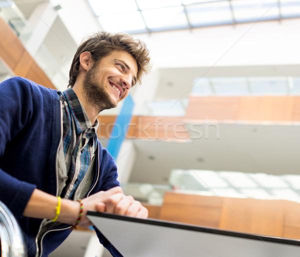 Young man sitting and having fun Stock photo © zurijeta
