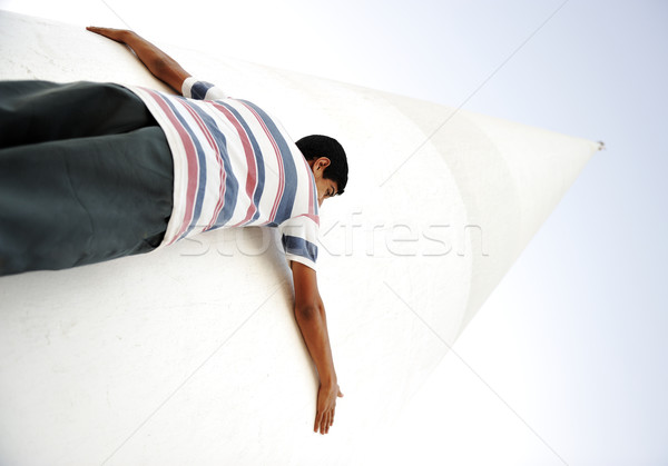 A human holding giant pillar, small and big, low and high Stock photo © zurijeta