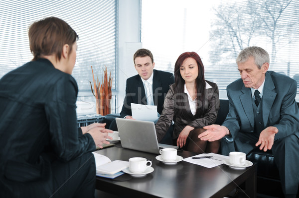 Businesswoman in an interview with three business people getting bad results Stock photo © zurijeta