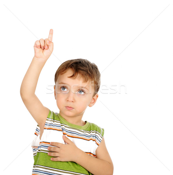 Boy points his finger upwards Stock photo © zurijeta