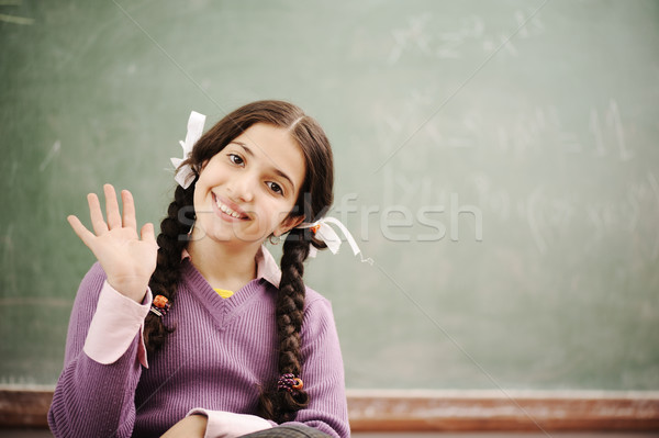 Cute little girl at school saying HI Stock photo © zurijeta